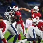 Palmer Suffers Broken Arm , Cardinals Blanked by Rams